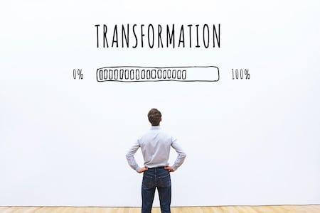Man looking up at a transformation status bar